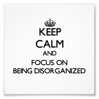 Guarde la calma y el foco en la desorganización fotografías