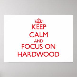 Guarde la calma y el foco en la madera dura impresiones