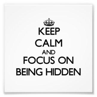 Guarde la calma y el foco en la ocultación fotografías