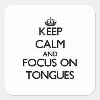 Guarde la calma y el foco en las lenguas colcomania cuadrada