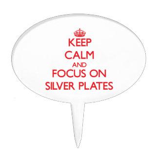 Guarde la calma y el foco en las placas de plata