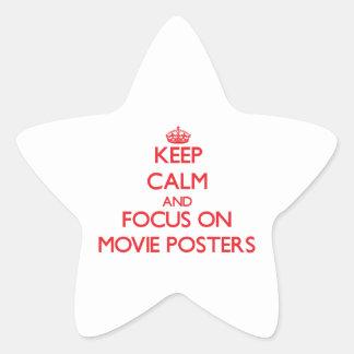 Guarde la calma y el foco en los carteles de pelíc