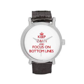 Guarde la calma y el foco en los fondos relojes de pulsera