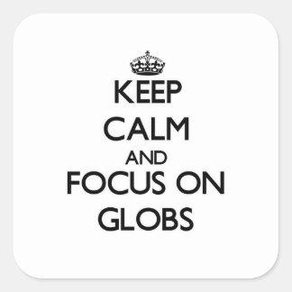Guarde la calma y el foco en los Globs Pegatina Cuadradas