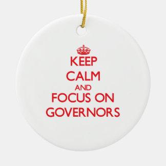 Guarde la calma y el foco en los gobernadores ornamente de reyes