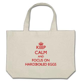 Guarde la calma y el foco en los huevos duros bolsas lienzo