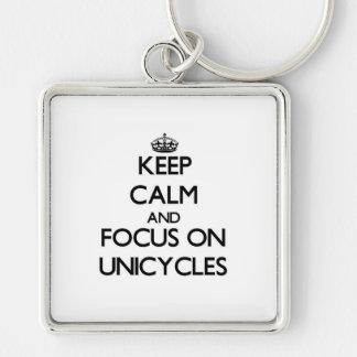 Guarde la calma y el foco en los Unicycles Llaveros