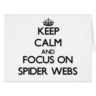 Guarde la calma y el foco en los Web de araña Tarjetón