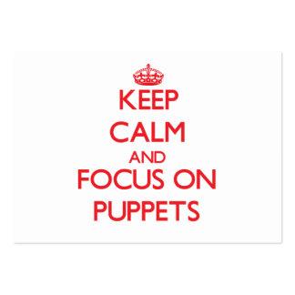 Guarde la calma y el foco en marionetas tarjeta de visita