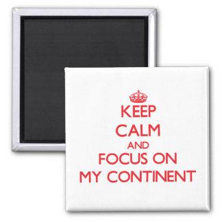 Guarde la calma y el foco en mi continente imán de frigorifico