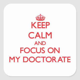 Guarde la calma y el foco en mi doctorado calcomanía cuadradas