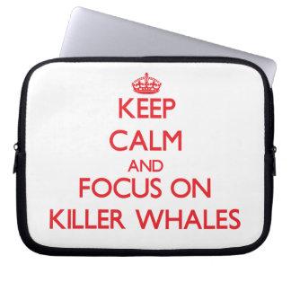 Guarde la calma y el foco en orcas mangas portátiles