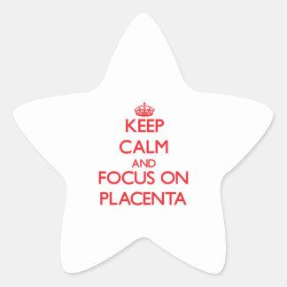 Guarde la calma y el foco en placenta pegatina en forma de estrella