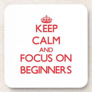 Guarde la calma y el foco en principiantes posavasos