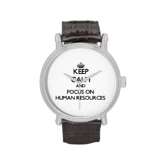 Guarde la calma y el foco en recursos humanos reloj de mano