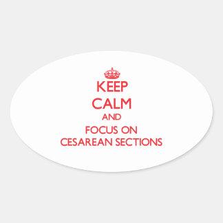 Guarde la calma y el foco en secciones cesarianas pegatina ovalada