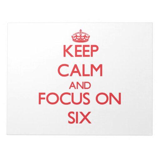 Guarde la calma y el foco en seis libreta para notas