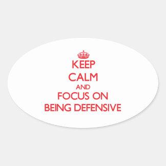 Guarde la calma y el foco en ser defensivo colcomanias oval personalizadas