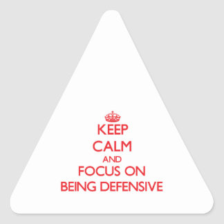 Guarde la calma y el foco en ser defensivo pegatinas triangulo