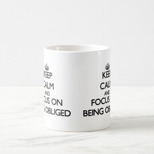 Guarde la calma y el foco en ser obligado tazas de café
