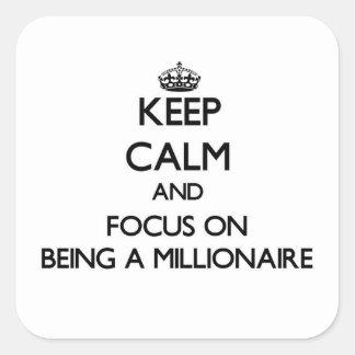 Guarde la calma y el foco en ser un millonario pegatina cuadrada