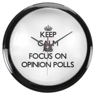 Guarde la calma y el foco en sondeos de opinión relojes pecera