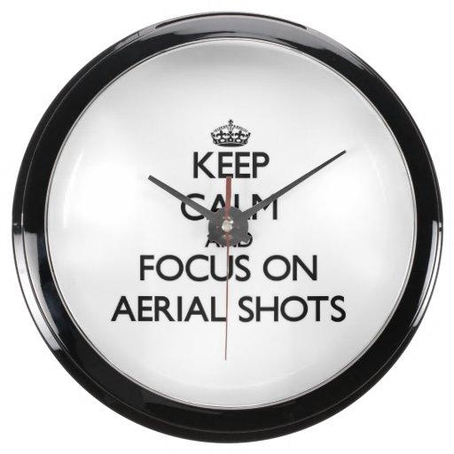 Guarde la calma y el foco en tiros aéreos relojes acuario