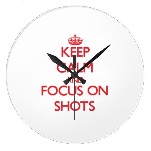 Guarde la calma y el foco en tiros reloj de pared