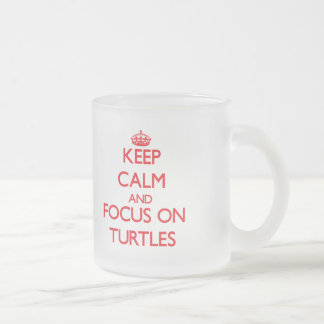 Guarde la calma y el foco en tortugas tazas
