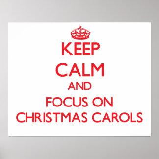 Guarde la calma y el foco en villancicos del navid posters