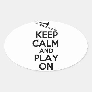 Guarde la calma y el juego en (el Trombone) Pegatina Ovalada