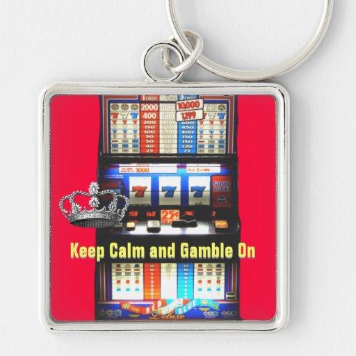 Guarde la calma y el juego en la máquina tragaperr llavero cuadrado plateado