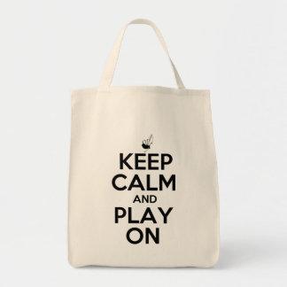 Guarde la calma y el juego en las gaitas bolsa tela para la compra