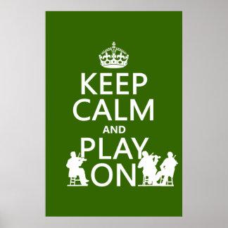 Guarde la calma y el juego en (los instrumentos at impresiones