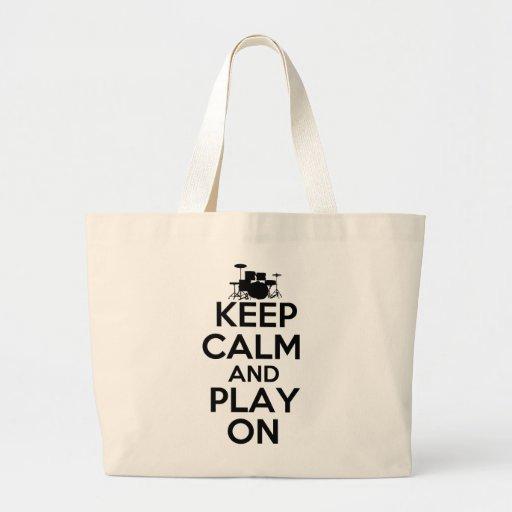Guarde la calma y el juego en (los tambores) bolsa de mano