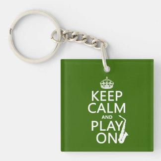 Guarde la calma y el juego en (saxofón) (cualquier llaveros
