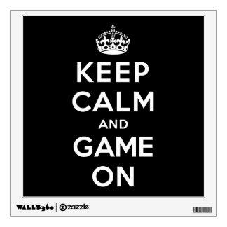Guarde la calma y el juego encendido vinilo adhesivo