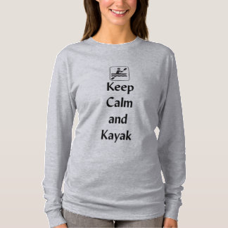 Guarde la calma y el kajak playera
