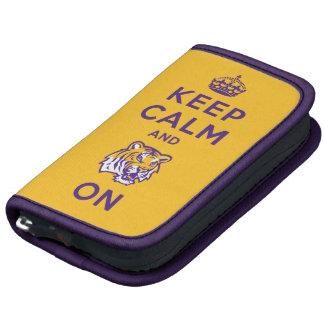Guarde la calma y el tigre en púrpura planificadores