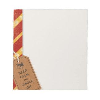 Guarde la calma y el tintineo en la libreta blocs de papel