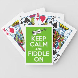 Guarde la calma y el violín en (el verde) baraja de cartas