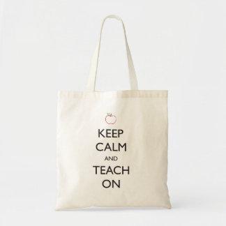 Guarde la calma y enséñela encendido bolsa lienzo