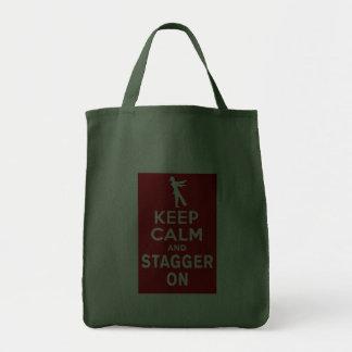 Guarde la calma y escalónela en diseño del zombi d bolsa