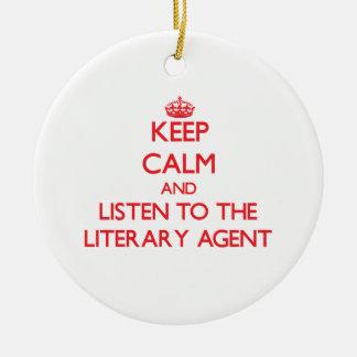 Guarde la calma y escuche el agente literario adorno redondo de cerámica