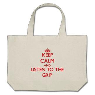 Guarde la calma y escuche el apretón bolsas
