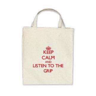 Guarde la calma y escuche el apretón bolsa lienzo