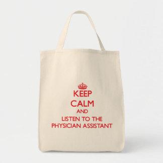 Guarde la calma y escuche el ayudante del médico bolsa