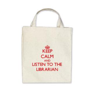 Guarde la calma y escuche el bibliotecario bolsas