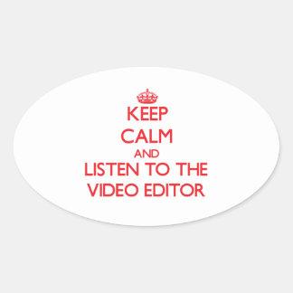 Guarde la calma y escuche el editor de vídeo pegatina óval