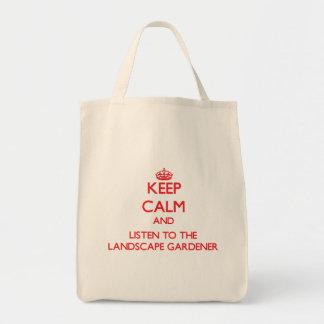 Guarde la calma y escuche el jardinero de paisaje bolsas lienzo
